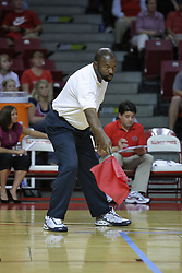 28 AUG 2009: Pointing the flag to the field of play, a line judge Greg White calls a ball in bounds. The Redbirds of Illinois State defeated the Runnin' Bulldogs of Gardner-Webb in 3 sets during play in the Redbird Classic on Doug Collins Court inside Redbird Arena in Normal Illinois