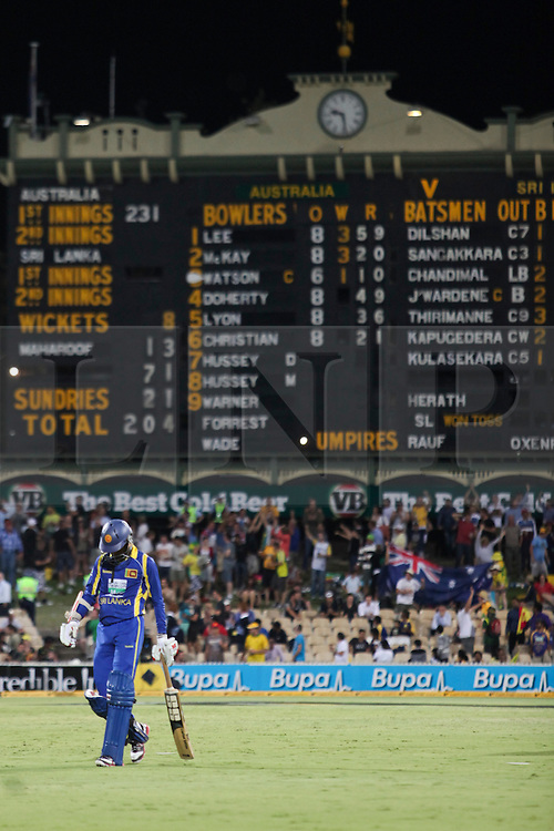 © Licensed to London News Pictures. 08/03/2012. Adelaide Oval, Australia. Upul Tharanga walks off after being dismissed for a well fought 71 runs during the One Day International cricket match final between Australia Vs Sri Lanka. Photo credit : Asanka Brendon Ratnayake/LNP