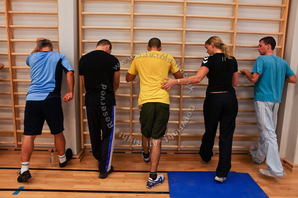 Inmates are taking part to a stretching session with their female trainer during the time they regularly spend carrying out physical exercise and learning about the human body inside the luxurious Halden Fengsel, (prison) near Oslo, Norway.