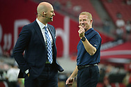 GLENDALE, AZ - SEPTEMBER 25:  Head coach Jason Garrett of the Dallas Cowboys (R) talks with ESPN analysts Matt Hasselbeck prior to the NFL game against the Arizona Cardinals at University of Phoenix Stadium on September 25, 2017 in Glendale, Arizona.  (Photo by Jennifer Stewart/Getty Images)
