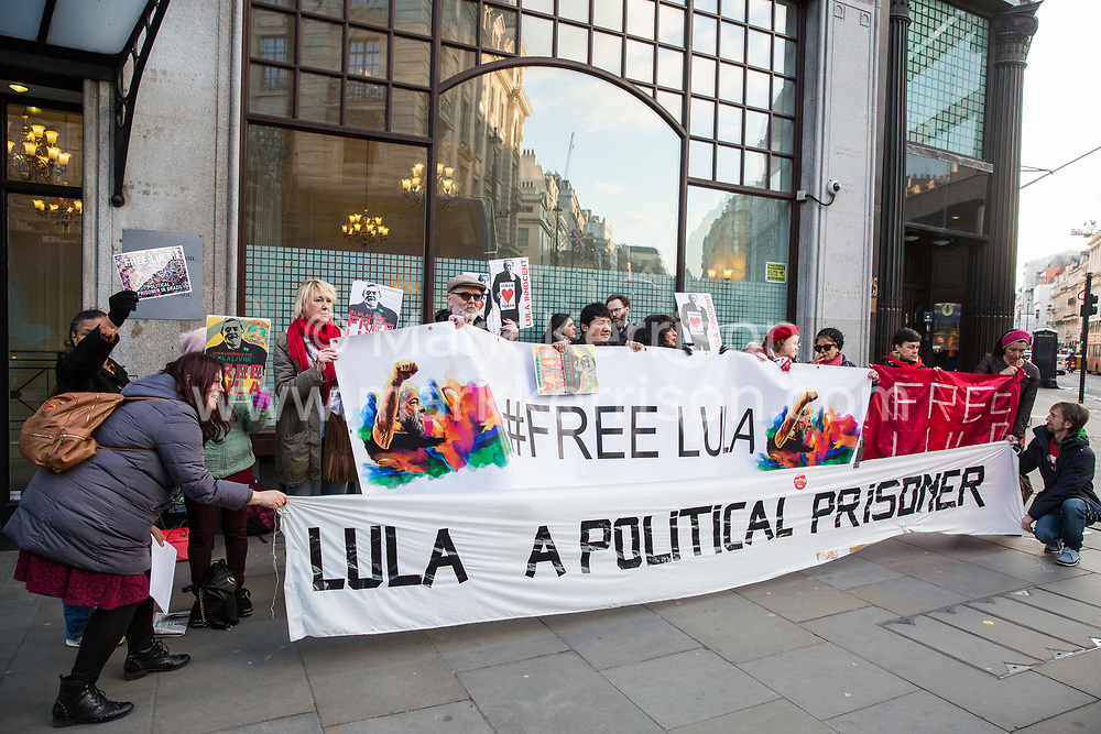 London, UK. 10th April 2019. Activists from the Free Lula International Committee protest outside the Brazilian embassy to demand the release of former President Lula, to denounce his incarceration as a political prisoner, and the mode in which he was replaced by President Bolsonaro and to call on the international community to participate in demonstrations of solidarity with Lula and the Brazilian people.