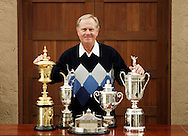 Jack Nicklaus poses with his favorite major trophies. <br /> US Amateur, British Open, Masters, PGA, US Open<br /> <br /> Picture Credit: Robert Walker / visionsingolf.com