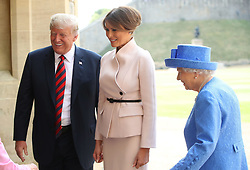 US President Donald Trump and first lady Melania Trump with Queen Elizabeth II in the Quadrangle at Windsor Castle, Windsor.