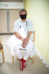 © Licensed to London News Pictures . 21/05/2020 . Manchester , UK . Patient GIOVANNI PISANI (49 from Stockport) waits outside an operating theatre ahead of being given a biopsy , which will be used to assess the success of his previous treatment . Specialist cancer centre , The Christie Hospital , is adapting in order to ensure the safety of patients and staff . They are reporting a drop in referrals during the UK's Coronavirus lockdown and there is concern that cancers are going undiagnosed and untreated . Photo credit : Joel Goodman/LNP