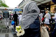 ROTTTERDAM - Silent mars for owner Jenny Loh, her mother and her husband, chef cook Shun Po Fan of the Asian Glories restaurant standing in a row during a memorial service. The three died in the plane crash with the MH17 Malaysia Airlines in Ukraine. COPYRIGHT ROBIN UTRECHT  In Rotterdam is maandagavond een stille tocht voor de bij de vliegramp omgekomen eigenaren van restaurant Asian Glories. Het initiatief kwam van collega's van de eigenaren, in overleg met hun zoon. Herman den Blijker en burgemeester Aboutaleb .