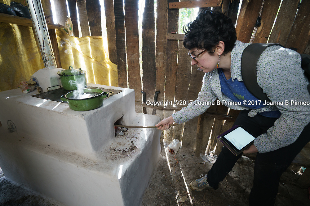 Clean Cooking Biomass Stove, Honduras. Bonnie Young, Ph.D, Honduras Cookstove team, inspects one of the clean cookstoves that is part of the epidemiologic intervention study in Honduras. During this initial study, a partnership between CSU and Trees, Water & People (TWP) was formed. TWP has been working with communities and local NGOs to develop and distribute culturally acceptable cookstoves in Central America for decades and this partnership continues to be one of the most important features of our cookstove research.