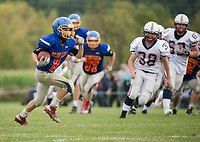 Gilford-Belmont's Evan Merrifield runs the ball during NHIAA Division II football with Plymouth on Saturday afternoon at the Meadows Field.  (Karen Bobotas/for the Laconia Daily Sun)