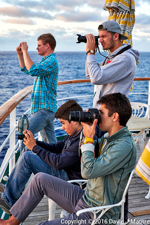 Sunrise photographers lined up on the aft deck of the MV World Odyssey.  Image taken with a Fuji X-T1 camera and 35 mm f/1.4 lens (ISO 200, 35 mm, f/3.2, 1/125 sec).