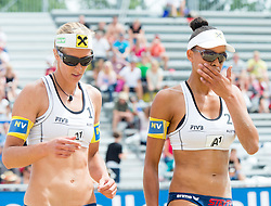 30.07.2014, Strandbad, Klagenfurt, AUT, FIVT, A1 Beachvolleyball Grand Slam 2014, Hauptrunde, im Bild Stefanie Schwaiger (AUT, L) und Lisa Chukwuma (AUT, R) // during Main Draw Match of the A1 Beachvolleyball Grand Slam at the Strandbad Klagenfurt, Austria on 2014/07/30. EXPA Pictures © 2014, EXPA Pictures © 2014, PhotoCredit: EXPA/ Johann Groder