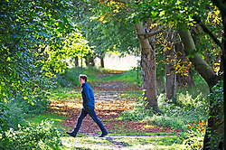 ©Licensed to London News Pictures 18/10/2019.<br /> Sidcup,UK, A young man walking along a footpath. An autumnal October afternoon at Footscray Meadows on the River Cray, Sidcup, South East London. Photo credit: Grant Falvey/LNP