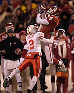 University of Oklahoma wide receiver Malcolm Kelly (4) catches a nine yard pass over Nebraska defensive back Cortney Grixby (2) in the second half, during the Big 12 Championship game at Arrowhead Stadium in Kansas City, Missouri, December 2, 2006.  Oklahoma beat Nebraska 21-7.<br />