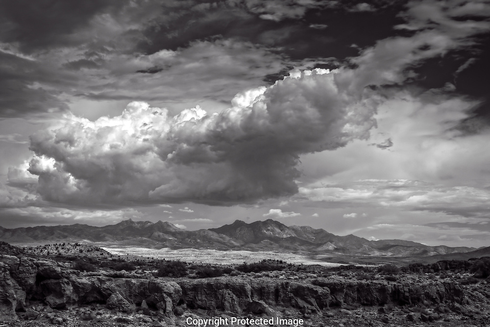 Black and white photograph of massive storm cloud formation over the Hualapai mountains of northern Arizona