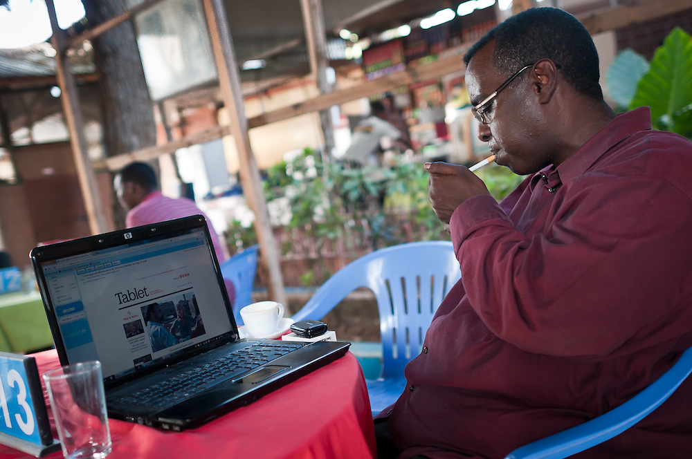 Osman Ahmed Sudi, a Somali diaspora who lived in Holland, returned to Somalia to work for the National Security at Aden Abdulle International Airport. At Village Cafe, he uses wifi to check news, email, and Tracy Chapman videos on YouTube.
