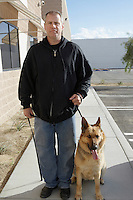 Portrait of security guard with dog, outdoors