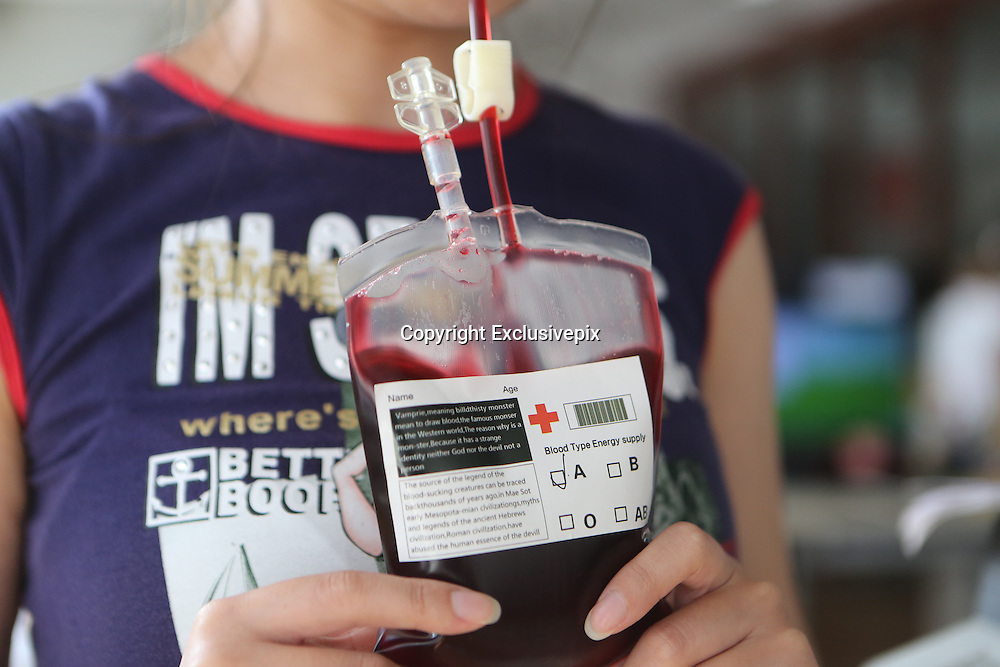 "BENXI, CHINA - JUNE 25: (CHINA OUT) <br /> <br /> Blood Bag Beverage<br /> <br /> ""Blood Bag"", a crimson beverage offered with two flavors of blueberry and cranberry, is seen on June 25, 2014 in Benxi, Liaoning province of China. ""Blood Bag"", a crimson beverage was marked by the sign of ""Blood Type Energy Supply"" and the symbol of Red Cross and the beverage was for sale with the price of 30 RMB (about 4.8 USD) in China\s northeast city of Benxi.<br /> ©Exclusivepix"