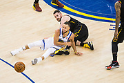 Golden State Warriors guard Stephen Curry (30) battles Cleveland Cavaliers center Kevin Love (0) on the floor for a loose ball during Game 1 of the NBA Finals at Oracle Arena in Oakland, Calif., on May 31, 2018. (Stan Olszewski/Special to S.F. Examiner)