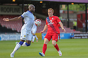 Sol Bamba & Danny Johnson during the Friendly match between York City and Leeds United at Bootham Crescent, York, England on 15 July 2015. Photo by Simon Davies.