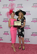 Tennis legend and Longines Ambassador of Elegance Stefanie Graf, right, presents Krista Rosenberg, of Boca Raton, FL, with a Longines DolceVita timepiece following her win of the Longines Kentucky Oaks Day Fashion Contest, Friday, May 5, 2017, in Louisville, KY. Longines, the Swiss watch manufacturer known for its luxury timepieces, is the Official Watch and Timekeeper of the 143rd annual Kentucky Derby. (Photo by Diane Bondareff/AP Images for Longines)