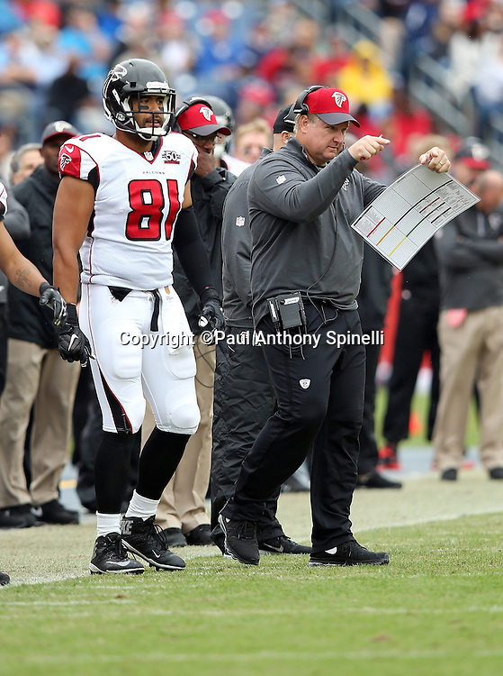Atlanta Falcons defensive coordinator Richard Smith points while standing next to Atlanta Falcons tight end Tony Moeaki (81) on the sideline during the 2015 week 7 regular season NFL football game against the Tennessee Titans on Sunday, Oct. 25, 2015 in Nashville, Tenn. The Falcons won the game 10-7. (©Paul Anthony Spinelli)