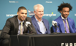 June 22, 2018 - Charlotte, NC, USA - Charlotte Hornets first and second round draft picks Miles Bridges, left, and Devonte' Graham, right, answer questions from the media as they sit with President of Basketball Operations & General Manager Mitch Kupchak during their introductory news conference at Spectrum Center in Charlotte, N.C., on Friday, June 22, 2018. (Credit Image: © David T. Foster Iii/TNS via ZUMA Wire)