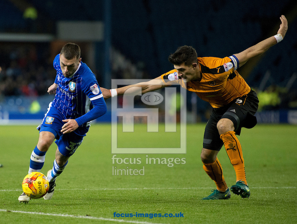 Jack Hunt of Sheffield Wednesday (left) looks to find a way past Danny Batth of Wolverhampton Wanderers during the Sky Bet Championship match at Hillsborough, Sheffield<br /> Picture by Russell Hart/Focus Images Ltd 07791 688 420<br /> 02/01/2017