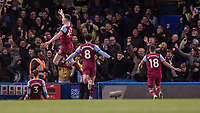 Football - 2019 / 2020 Premier League - Chelsea vs. West Ham United<br /> <br /> West Ham players celebrate in front of their travelling fans after Aaron Cresswell (West Ham United) gives them the lead at Stamford Bridge <br /> <br /> COLORSPORT/DANIEL BEARHAM