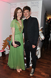 SOPHIE ELLIS-BEXTOR and RICHARD JONES at a party to celebrate the launch of the Lucy in Disguise Ready to Wear collection exclusive to Harvey Nichols, held at The Fifth Floor Restaurant, Harvey Nichols, Knightsbridge, London on 25th May 2011.