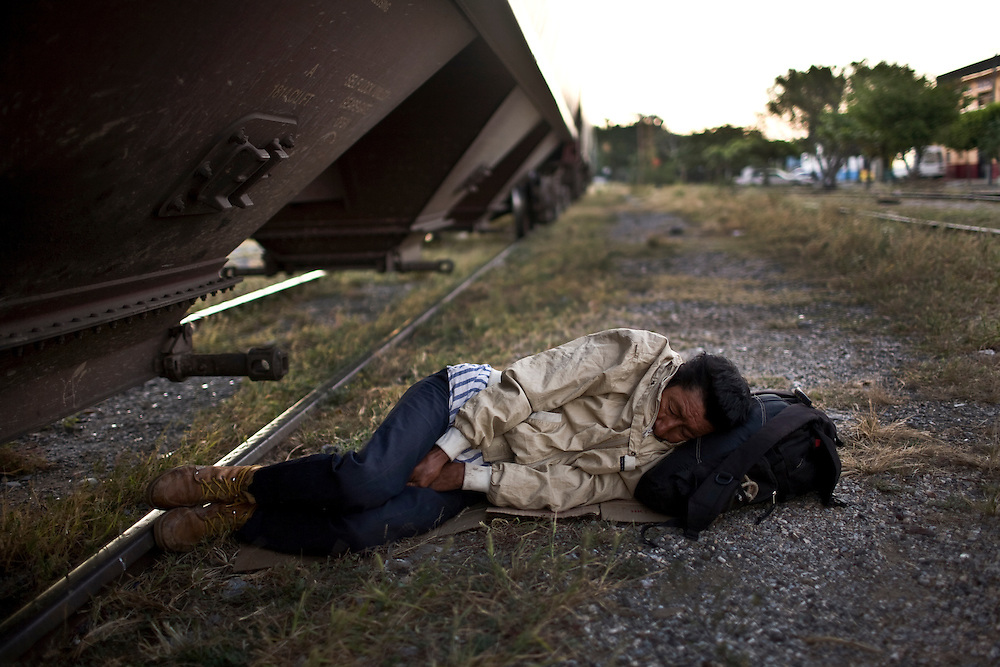 Migrants spend the early morning in Arriaga, Chiapas waiting to hop a freight train that will take them north. Traveling by train has become more dangerous as kidnappings and robberies have risen in recent years with increase drug cartel activity.