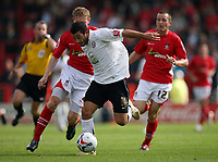 Photo: Rich Eaton.<br /> <br /> Wrexham v Hereford United. Coca Cola League 2. 24/09/2006. Stuart Fleetwood right of Hereford and Wrexhams Lee Roche fight for the ball