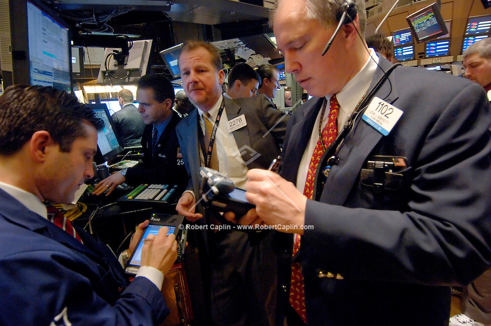 Traders on the floor of the New York Stock Exchange begin the day of trading Tuesday, January 24, 2006.