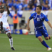 Rodolfo Zelaya, El Salvador, (right) challenges Seon Power, Trinidad and Tobago, during the El Salvador Vs Trinidad and Tobago CONCACAF Gold Cup group B football match at Red Bull Arena, Harrison, New Jersey. USA. 8th July 2013. Photo Tim Clayton