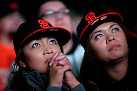 SAN FRANCISCO, CA - NOV 1:  Angela Short and Charlene Mendoza both of Vallejo, California watch the Giants defeat the Texas Rangers to win the World Series in 5 games at the Civic Center Plaza on November 1, 2010 in San Francisco, California.  The Giants won their first World Series in 56 years since moving to San Francisco from New York.  Photograph by David Paul Morris