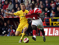 Photo: Olly Greenwood.<br />Charlton Athletic v Watford. The Barclays Premiership. 21/10/2006. Charlton's Jimmy Floyd Hasselbaink tangles with Watford's Jay Demerit.