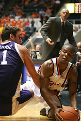 Virginia point guard Sean Singletary (44) fights off Northwestern's Vedran Vukusic (11) for a loose ball in the second half with UVA head coach Dave Leitao.  Singletary's game high 23 points led the Cavs to a 72-57 over the Wildcats in the ACC/BigTen Challenge...The Virginia Cavaliers Men's Basketball team defeated the Northwestern Wildcats 72-57 in the ACC/BigTen Challenge at University Hall in Charlottesville, VA on November 30, 2005..