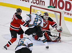 February 20, 2008; Newark, NJ, USA;  New Jersey Devils goalie Martin Brodeur (30) makes a pad save while New Jersey Devils defenseman Sheldon Brookbank (8) defends against San Jose Sharks center Jeremy Roenick (27) during the third period at the Prudential Center in Newark, NJ.  The Devils beat the Sharks 3-2.