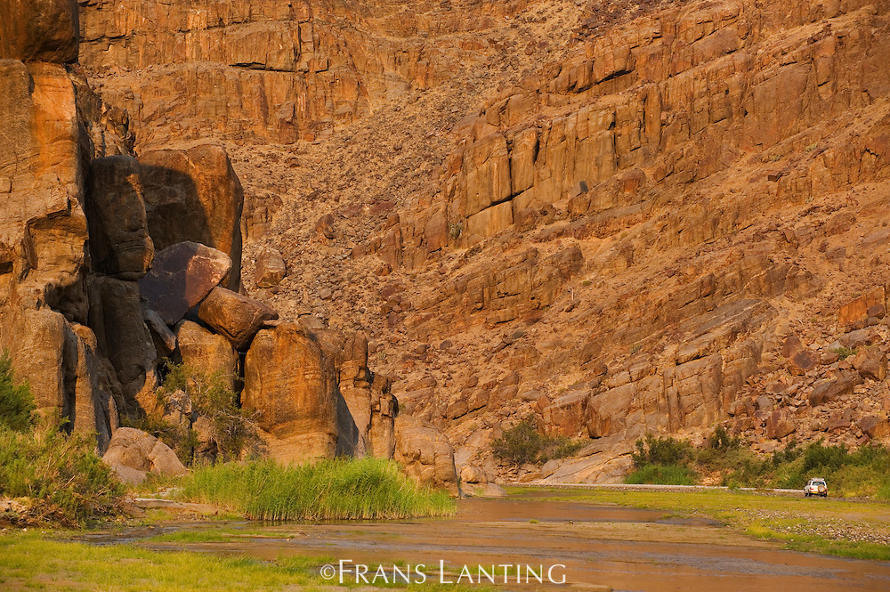 Vehicle in Hoarusib riverbed, Puros Conservancy, Damaraland, Namibia