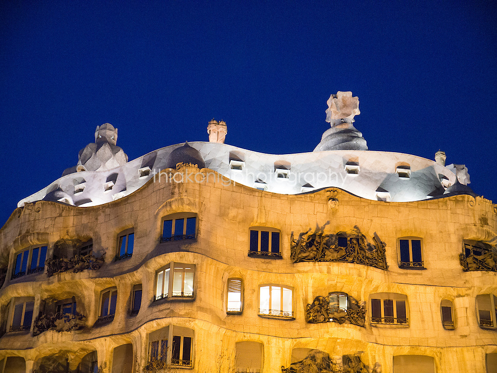 A graphic view of Casa Mila (La Padrera), by architect Gaudi at dusk, Barcelona, Spain.