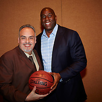 Magic Johnson posing with a fan .