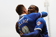Craig Westcarr celebrates with Jed Wallace after opening the scoring during the Sky Bet League 2 match between Portsmouth and Morecambe at Fratton Park, Portsmouth, England on 22 November 2014.