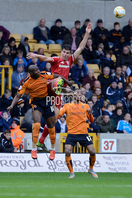 Wolverhampton Wanderers striker Benik Afobe beats Middlesbrough defender Daniel Ayala to a header during the Sky Bet Championship match between Wolverhampton Wanderers and Middlesbrough at Molineux, Wolverhampton, England on 24 October 2015. Photo by Alan Franklin.