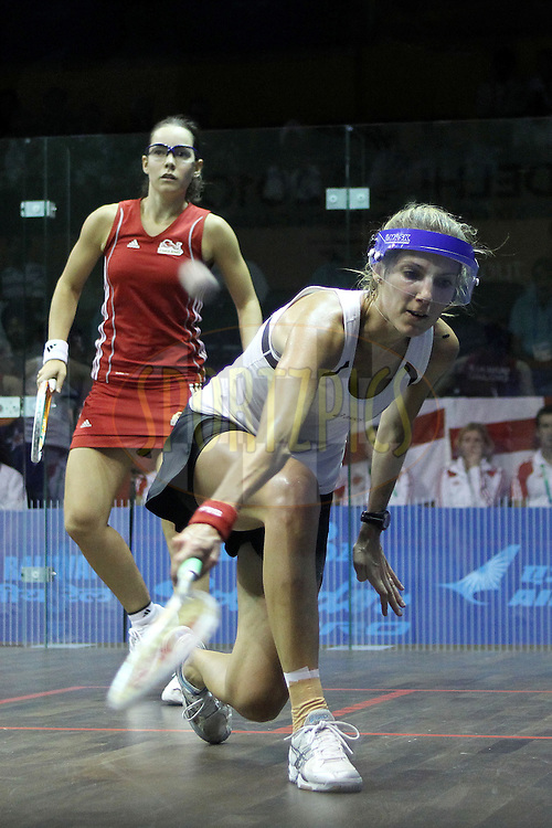 Jenny Duncalf of England and Jaclyn Hawkes of New Zealand during the final of the women's doubles squash competition held at the Siri Fort Complex in New Delhi as part of the XIX Commonwealth Games, India on the 13 October 2010..Photo by:  Ron Gaunt/photosport.co.nz
