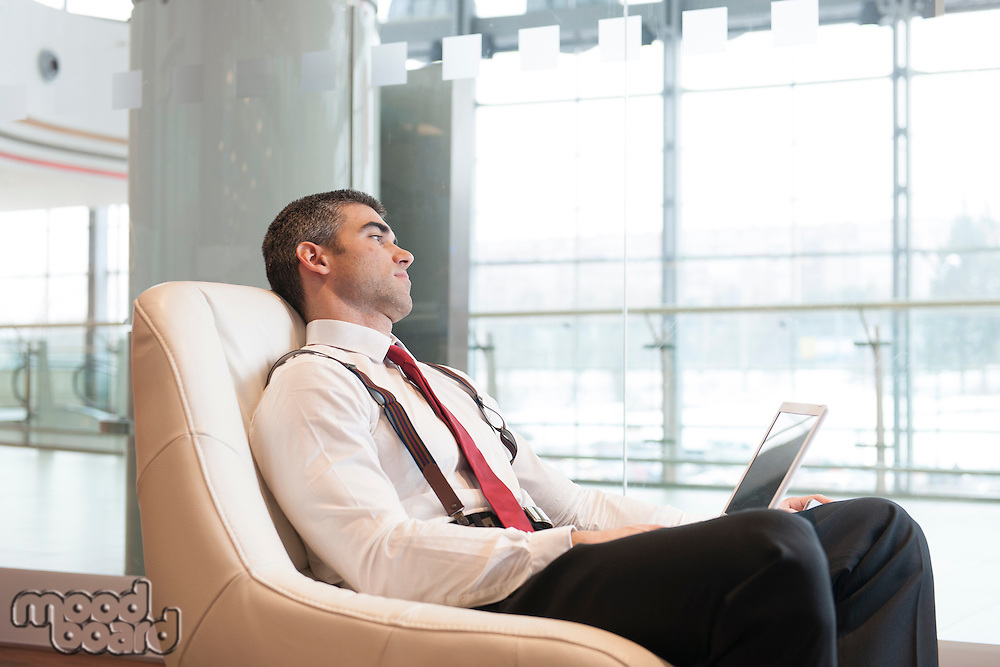 Bored businessman stares out window