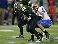 Kennedy's Trevor Heitland (33) is pulled down by Wahlert's Josh Tranel (9) on a run during the first half of the game between Cedar Rapids Kennedy and Dubuque Wahlert at Kingston Stadium in Cedar Rapids on Friday night, October 21, 2011.