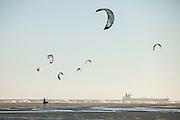 Kite boarder walks his kite as a cargo ship passes on Sullivan's Island, SC.