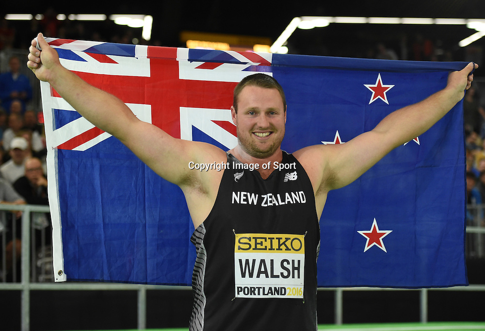 Mar 18, 2016; Portland, OR, USA; Tomas Walsh (NZL) poses with flag after winning the shot put during the 2016 IAAF World Championships in Athletics at the Oregon Convention Center. Copyright photo: Kirby Lee / www.photosport.nz