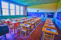 School Days: This dated school room is a gate way to the ways of the past; including the old flag, desks, chalk boards, wooden floors and in this case a multiple figure of a female teacher, Langley British Columbia Canada.