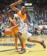 "Mississippi Rebels guard Jarvis Summers (32) drives on Tennessee Volunteers guard Detrick Mostella (15) at the C.M. ""Tad"" Smith Coliseum in Oxford, Miss. on Saturday, February 21, 2015. Mississippi won 59-57. (AP Photo/Oxford Eagle, Bruce Newman)"
