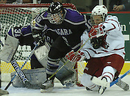 10/20/06 Omaha, NE University of Nebraska at Omaha's Alex Nikiforuk fights for the puck from Niagara's Ryan Annesley  and goalie Juliano Pagliero at Qwest Center Omaha..(Chris Machian/Prairie Pixel Group)..UNO won in the first game of the Maverick Stampede.