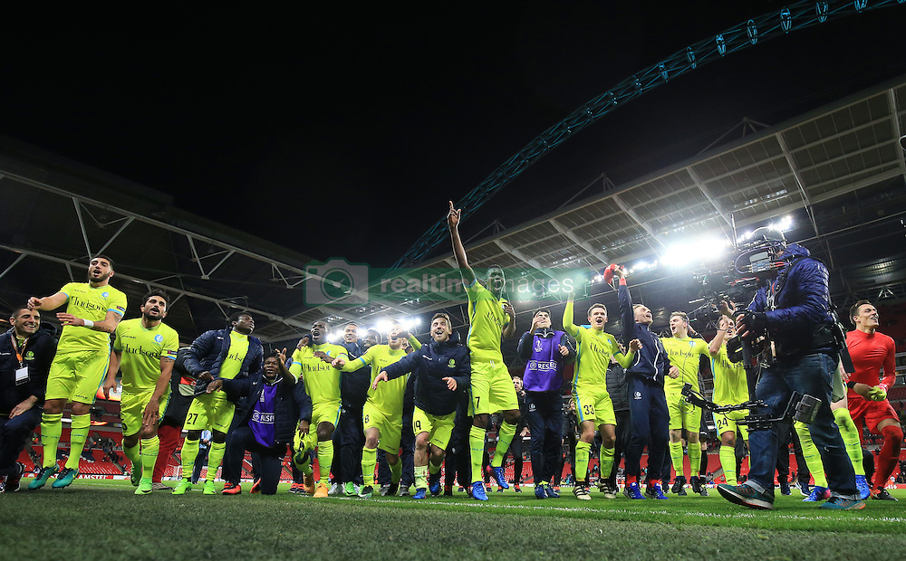 23 February 2017 - UEFA Europa League - (Round of 32) - Tottenham Hotspur v KAA Gent - Gent players celebrate victory under the Wembley arch- Photo: Marc Atkins / Offside.