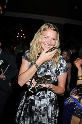 JODIE KIDD and snake at a party hosted by the Supper Club in honour of Mary Greenwell held at Beach Blanket Babylon, Ledbury Road, London on 25th June 2008.<br /><br />NON EXCLUSIVE - WORLD RIGHTS